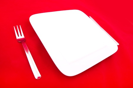 A blank plate isolated on red. photo