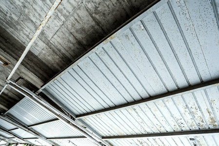 A industrial garage ceiling with open gates. photo