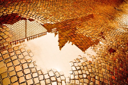 pebblestone: Reflections of Verona in a Puddle