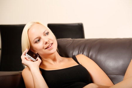 mobile voip: A blonde girl talking with a smartphone.