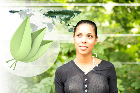 A young adult woman thinking green.