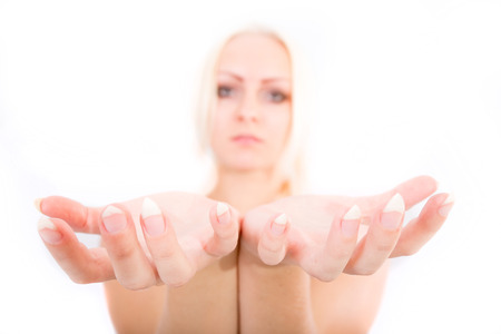 within: A young blonde girl holding something close to the observer.