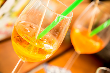 Alcoholic summer night drinks with ice cubes.