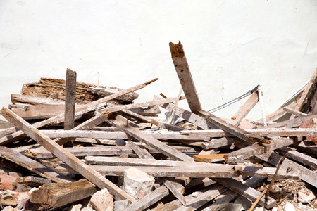demolished house: Wooden planks of a demolished house.