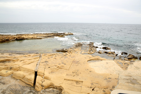 The rocky coast of Malta in Sliema. photo