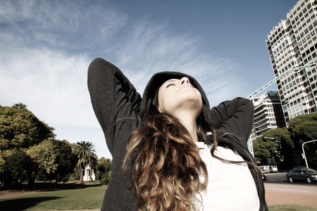 A young woman enjoying the sunlight in the Park.     photo