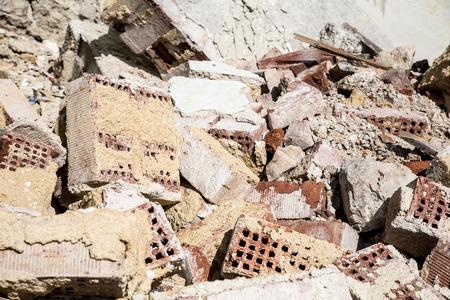 demolished house: Stones and bricks of a demolished house.
