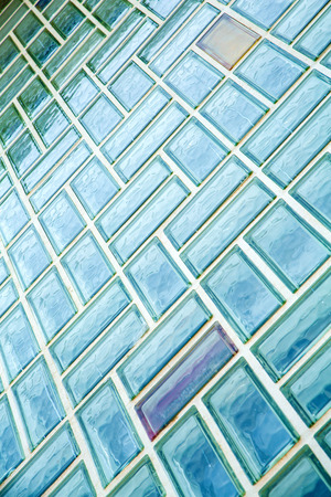 glass brick: A glass brick wall background. Architecture exterior.