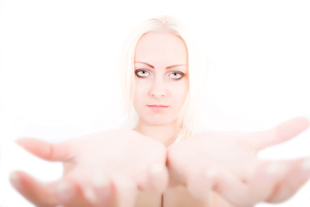 power within: A young blonde girl holding something close to the observer.