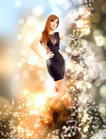 A young adult woman enjoying nightlife. Abstract Bokeh background. photo