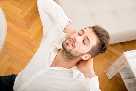 young adult man: A young adult man relaxing and stretching his back  Stock Photo