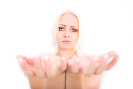 power within: A young blonde girl holding something close to the observer.  Stock Photo