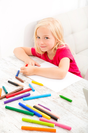 Daughter making colorful drawing at home. photo