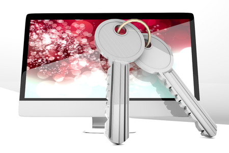 A modern All in one computer with a pair of Keys symbolizing security. Isolated on white. photo