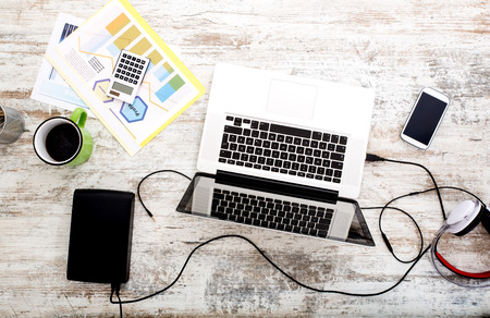 A modern home office setup on a wooden Table. Stock Photo