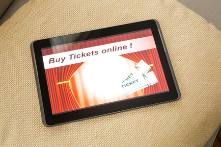 Buy cinema Tickets online with your mobile device or Tablet PC on the sofa. photo