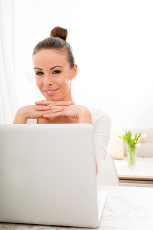 teleworker: Young woman working with a Laptop