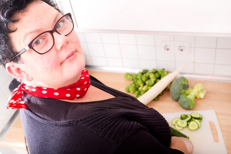cutting vegetables: Woman cutting vegetables