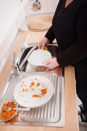 Woman washing dishes photo