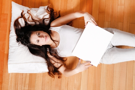 blank canvas: Young woman with a blank canvas Stock Photo