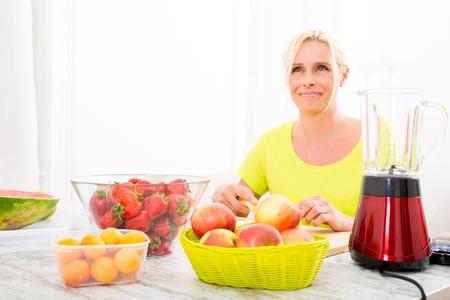 Mature woman enjoying a smoothie photo