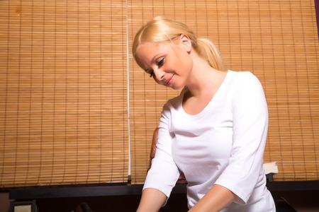 masseuse: A young beautiful masseuse applying a massage.