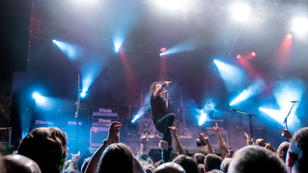 to thrash: BUDAPEST, HUNGARY - MARCH 13: The thrash metal band Overkill performing live on stage on the Killfest Tour on March 13, 2015 in Budapest, Hungary.
