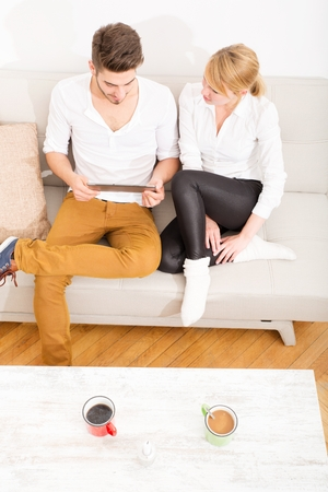 couple talking: Young couple talking on the Sofa Stock Photo