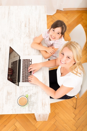 Mother and Daughter with a laptop photo