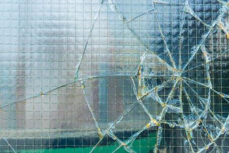 broken glass window: A broken industrial window.