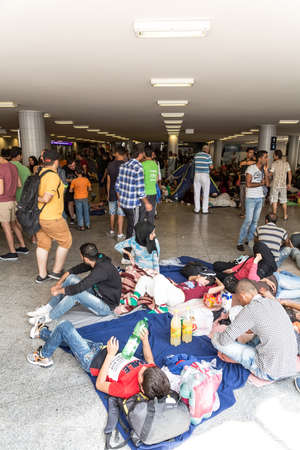astray: BUDAPEST, HUNGARY - SEPTEMBER 01: Stranded Refugees and Migrants camp in front of the eastern Train Station Keleti Palyudvar on September 01, 2015 in Budapest, Hungary.