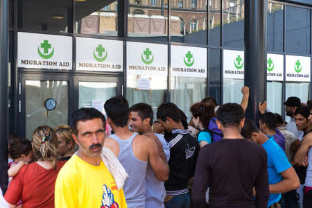 obtain: BUDAPEST, HUNGARY - SEPTEMBER 01: Stranded Refugees waiting to obtain support and medical care at the eastern Train Station Keleti Palyudvar on September 01, 2015 in Budapest, Hungary.