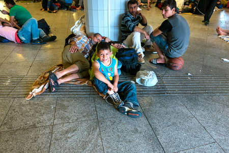 astray: BUDAPEST, HUNGARY - SEPTEMBER 01: Refugees and immigrants stranded in the underground section of the eastern Train Station Keleti Palyudvar on September 01, 2015 in Budapest, Hungary.