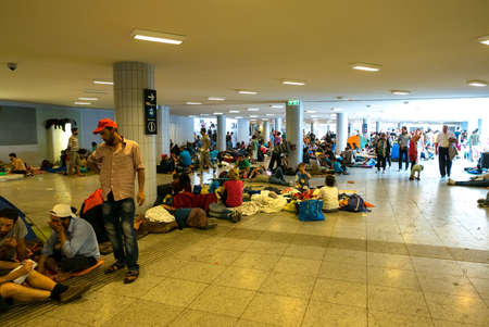 astray: BUDAPEST, HUNGARY - SEPTEMBER 01: Refugees and illegal immigrants stranded in the underground section of the eastern Train Station Keleti Palyudvar on September 01, 2015 in Budapest, Hungary.