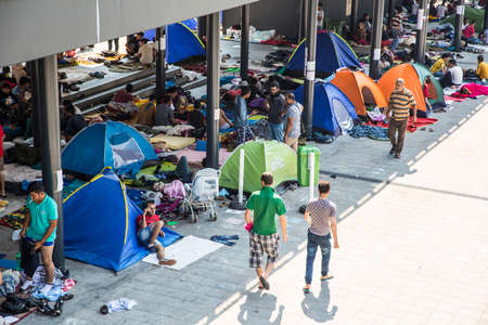 astray: BUDAPEST, HUNGARY - AUGUST 31: Refugees and illegal immigrants stranded at the eastern Train Station on August 31, 2015 in Budapest, Hungary. Editorial