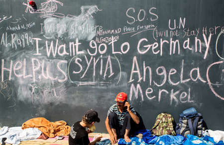 BUDAPEST, HUNGARY - SEPTEMBER 04: Syrian refugees demand help from Germany written on a wall at the Train Station Keleti Palyudvar on September 04, 2015 in Budapest, Hungary.