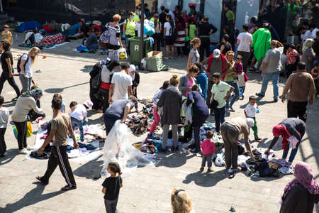 astray: BUDAPEST, HUNGARY - SEPTEMBER 04: Stranded Refugees and Migrants camp in front of the eastern Train Station Keleti Palyudvar on September 04, 2015 in Budapest, Hungary. Editorial