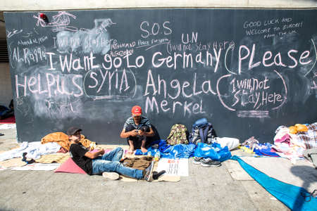 east germany: BUDAPEST, HUNGARY - SEPTEMBER 04: Syrian refugees demand help from Germany written on a wall at the Train Station Keleti Palyudvar on September 04, 2015 in Budapest, Hungary.