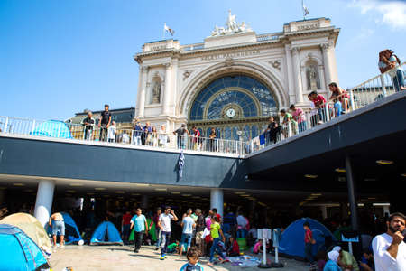 astray: BUDAPEST, HUNGARY - SEPTEMBER 04: Stranded Refugees in front of the eastern Train Station Keleti Palyudvar on September 04, 2015 in Budapest, Hungary.