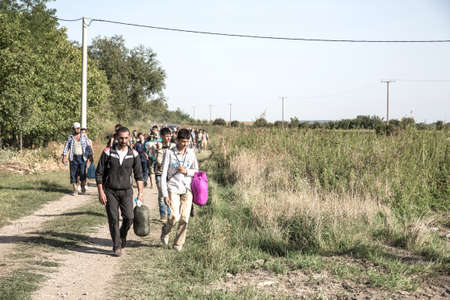 uncontrolled: TOVARNIK, CROATIA - SEPTEMBER 18: Refugees cross the uncontrolled border from Serbia to Croatia on September 18, 2015 in Tovarnik, Croatia.