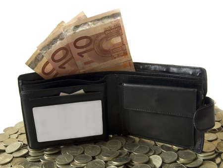 The black wallet with euro in it. Laying in the coins. There is a place for the text on the wallet. photo