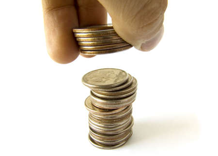 Coins column with fingers isolated Stock Photo