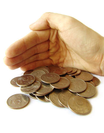 Photo of hand cvering heap of coins photo