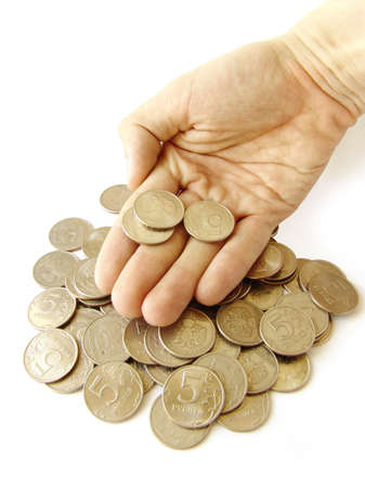 Heap of coins with hand over it photo