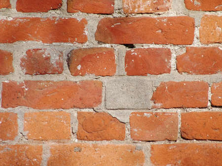 The abstract photo of the old and dirty red brick wall photo