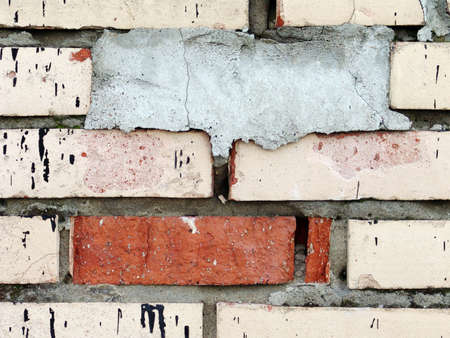 Photo of old and dirty white bricks with one cemented brick - to add your text on it. photo