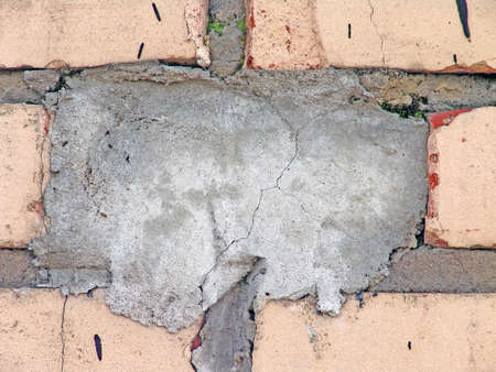 Cemented brick in the wall , can be used like an original background for  your text photo