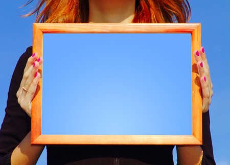 The photo of wood picture frame in hands of a woman with pink nails. You can use another fill inside of frame (white, yellow, pink) And add your text in it. Stock Photo - 436604