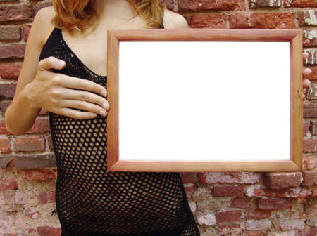The girl in transparent dress with empty frame for your texts or pictures photo