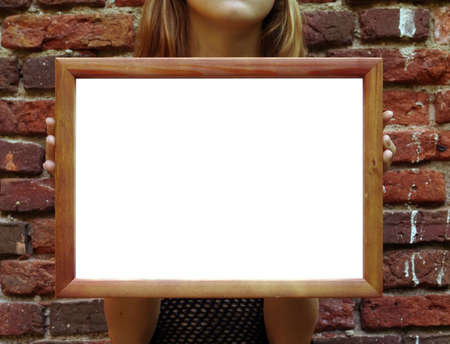 The girl with empty wooden frame, made  specially for you texts or pictures photo